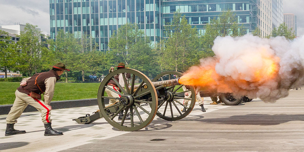 Patriot Week (sodiers in uniform firing ceremonial cannons at the MFH Memorial)